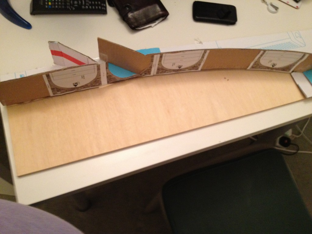 Using the cardboard mockup to mark out the plywood top